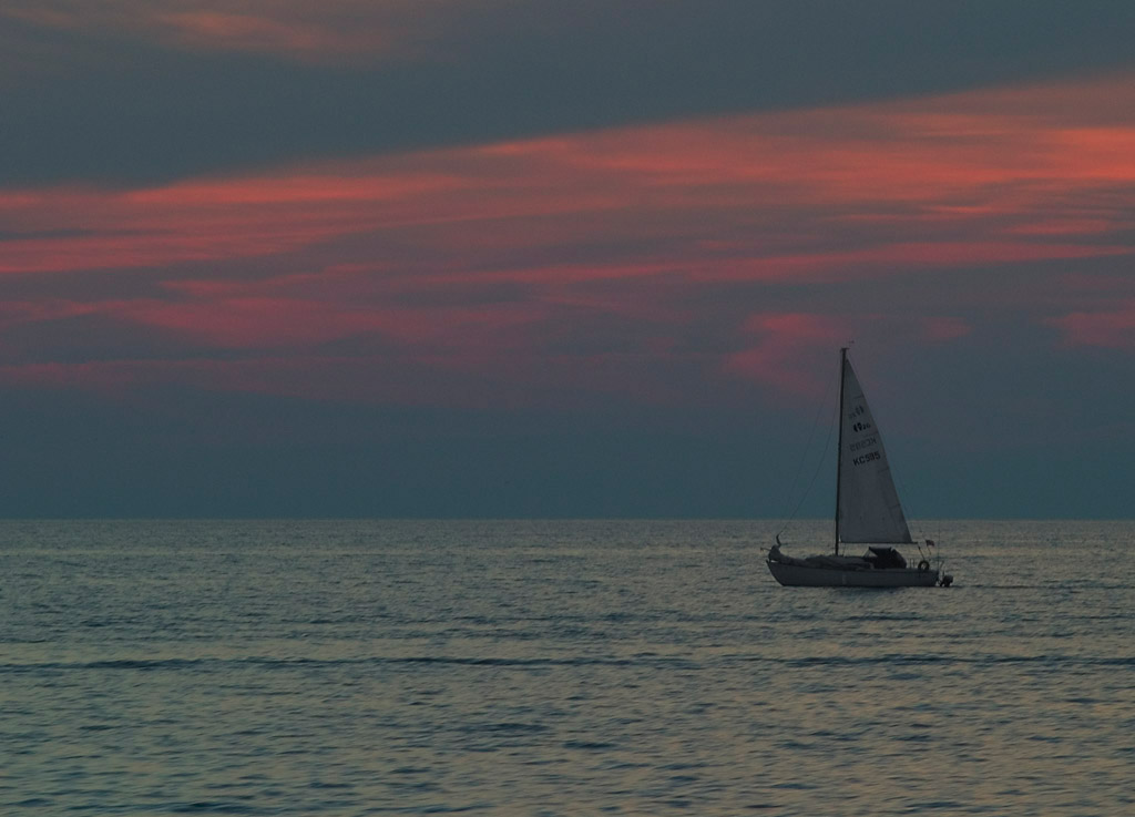 a sail at sunset